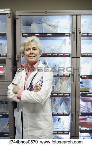 Stock Photography of Senior female doctor in supply room, Bethesda.