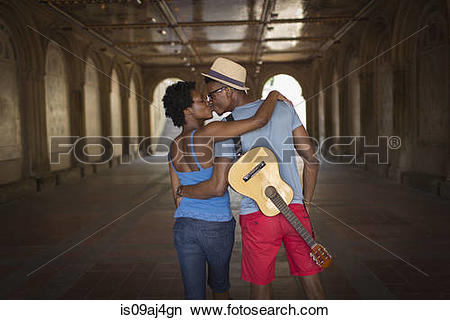 Stock Photo of Rear view of young couple with mandolin in Bethesda.