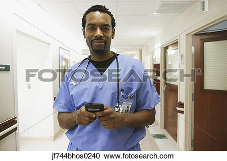 Stock Photography of African male surgeon using electronic.