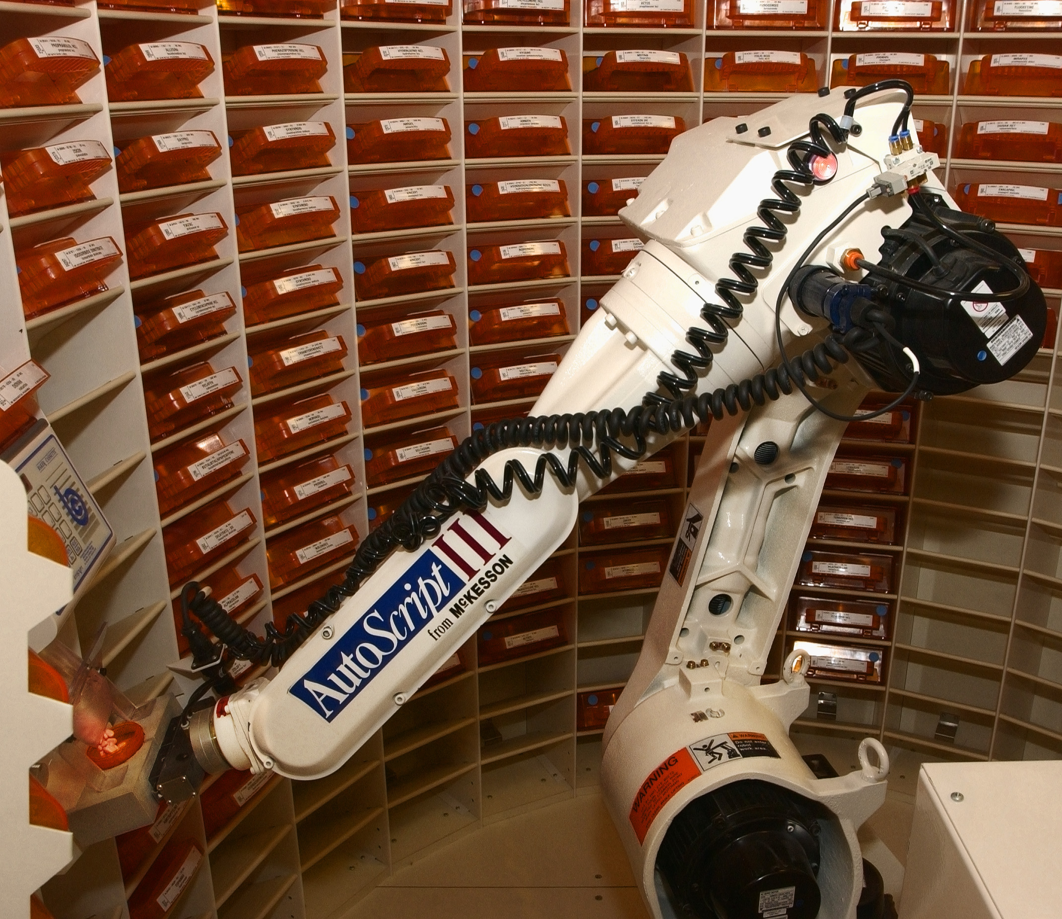 The Autoscript Robot Dispenses Medication Into A Bottle At The.