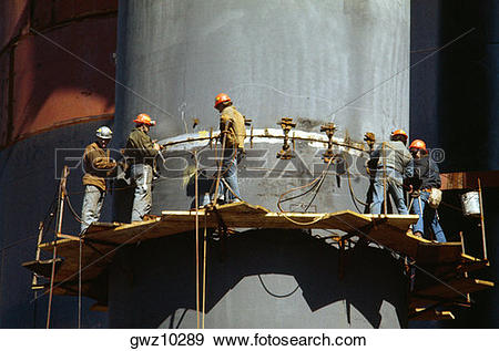 Stock Photograph of Steel workers working at a steel plant.
