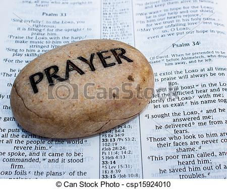 Stock Photography of prayer rock on an open bible.