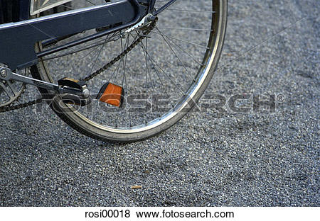 Pictures of bicycle, tar lining, rim, stones, reflectors, wheel.