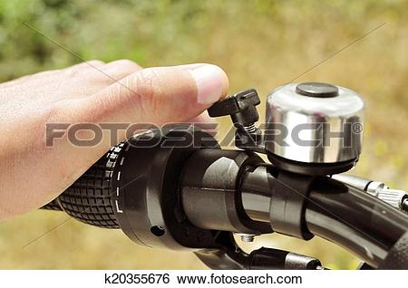Stock Images of man ringing a bicycle bell k20355676.