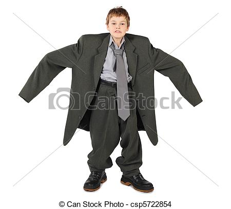 Stock Photo of little boy in big grey man's suit and boots nads at.