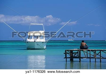Stock Images of Blue lagoon and big game fishing boat, Bain Beauf.