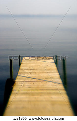 Stock Image of Soft focus lens turns lake and dock into dreamland.