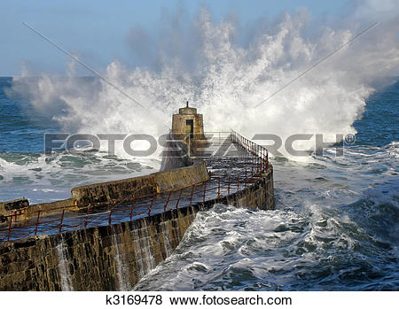 Pictures of Big wave splash on Portreath pier, Cornwall UK.