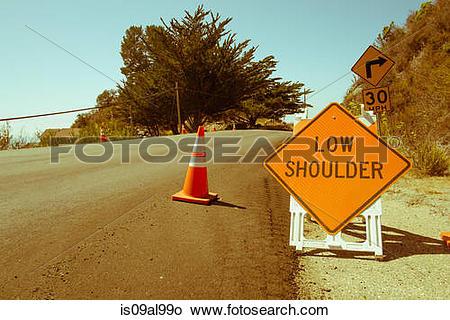 Stock Photo of Yellow warning sign, highway 1, Big Sur, California.