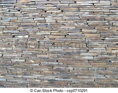 Stock Photography of fence from the grave stone tiles. big picture.