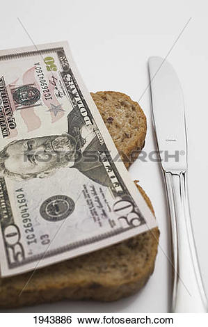 Stock Images of Us Fifty Dollar Bill On Top Of A Slice Of Bread.