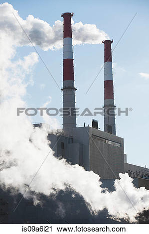 Stock Photography of Smoke billowing from industrial plant.