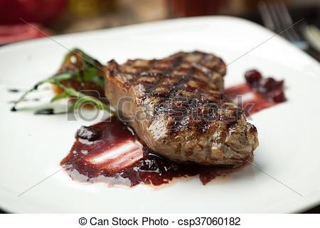 Pictures of Fat, juicy steak beef thick edge, grain.