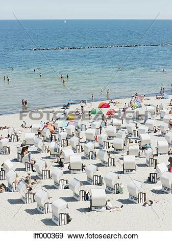 Stock Photograph of Germany,Ruegen, Binz, People in beach booth at.