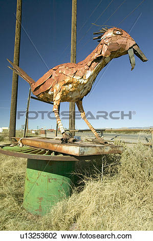 Stock Photo of Roadside bird made out of scrap metal along route.