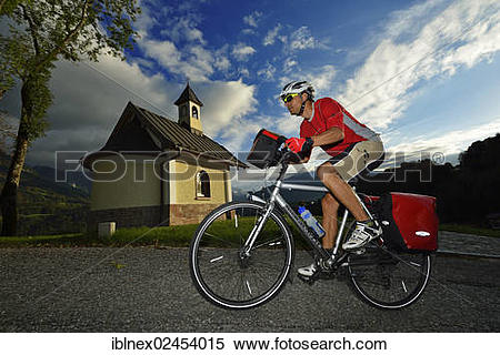 """Stock Image of """"Cyclist passing the Chapel of the Beatitudes on."""