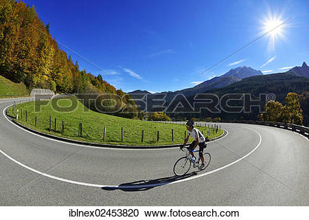 """Stock Photography of """"Cyclist riding along the Hochalpenstrasse, a."""