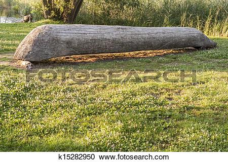 Stock Photography of Old wooden canoe in Biskupin Museum.