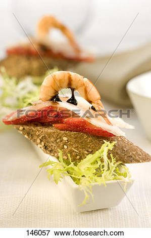 Picture of Cod Carpaccio,shrimp and strawberries on a bite.