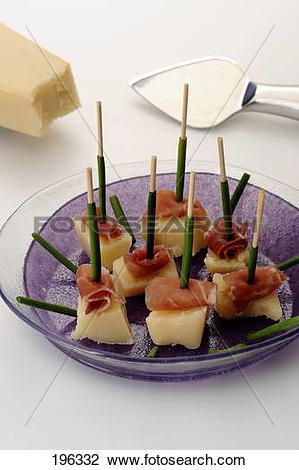 Stock Photo of Parmesan, serrano ham and chive bite.