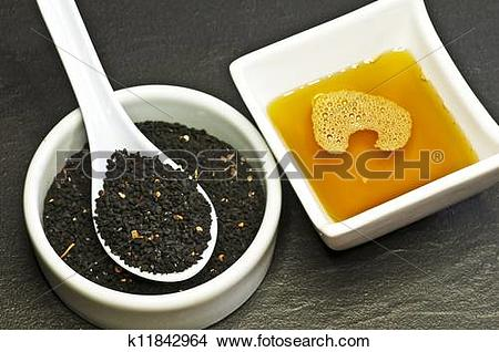 Stock Photo of black cumin seeds and black cumin oil k11842964.