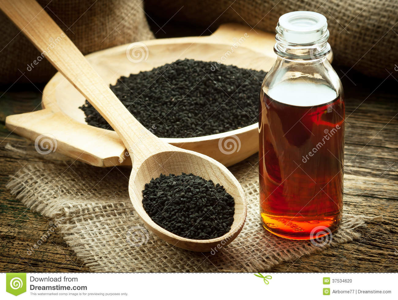 Nigella Sativa Or Black Cumin With Essential Oil Royalty Free.