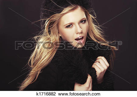 Stock Photo of Woman in black fur hat and coat k1716882.
