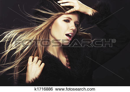 Stock Images of Woman in black fur hat and coat k1716886.