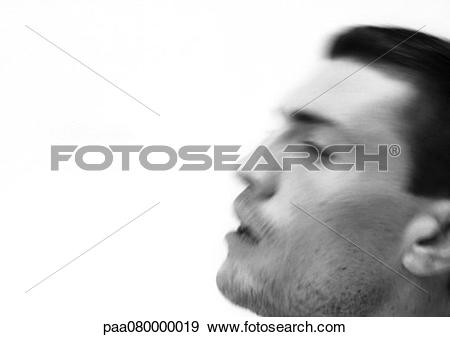 Stock Photograph of Man's face, side view, blurred, close.