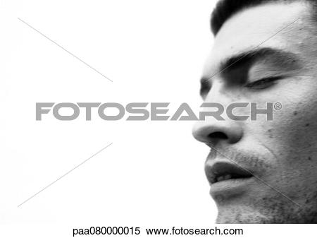 Stock Image of Man's face with eyes closed and mouth open, close.