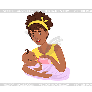 Young black mother breastfeeding her baby with.