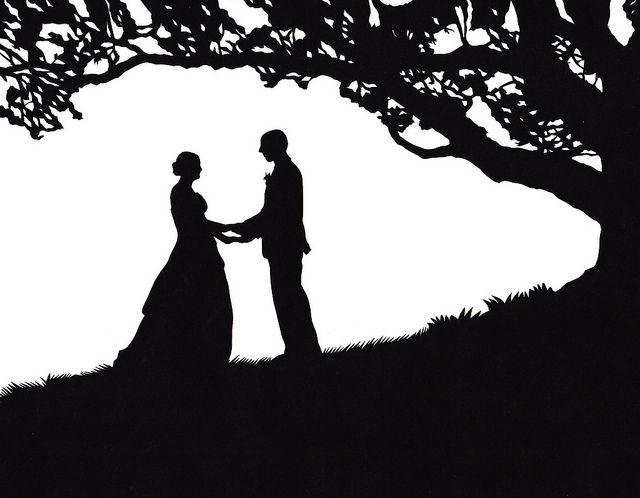 wedding under an oak tree silhouette.