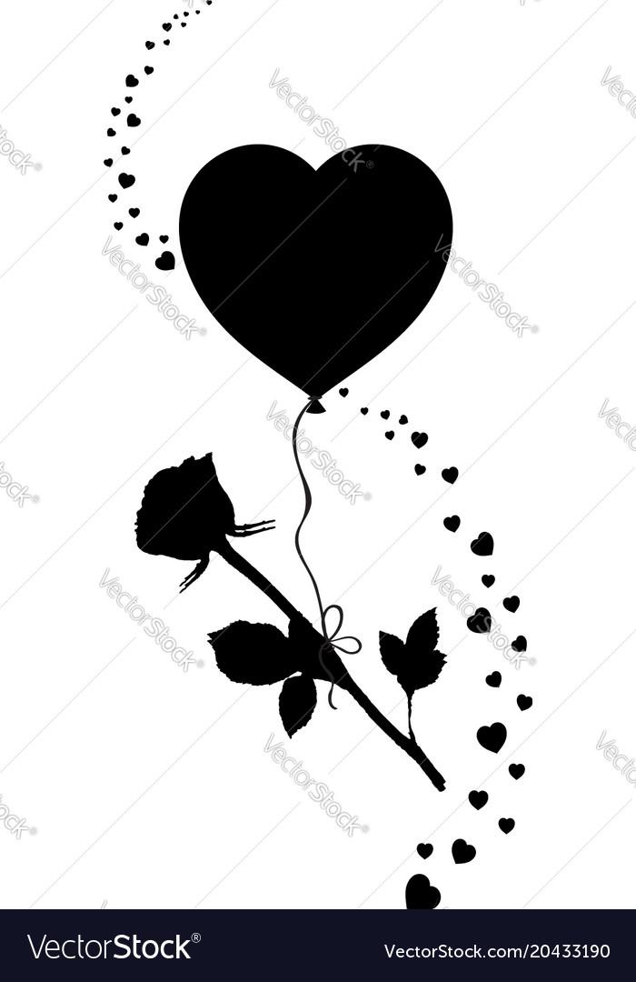 Black silhouette of rose flower flying on heart.