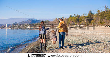 Picture of Family of three have fun near the Black Sea in winter.