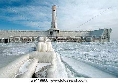 Stock Photography of Icy pier, frozen Black Sea, a rare phenomenon.