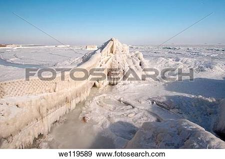 Stock Photograph of Icy pier, frozen Black Sea, a rare phenomenon.