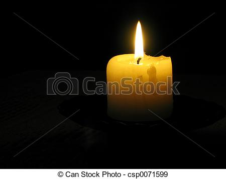 Stock Photographs of yellow candle in a dark room csp0071599.