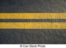 Stock Photographs of double yellow lines divider on blacktop.
