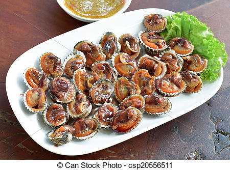 Stock Photography of Steamed blanched clams with dipping sauce.
