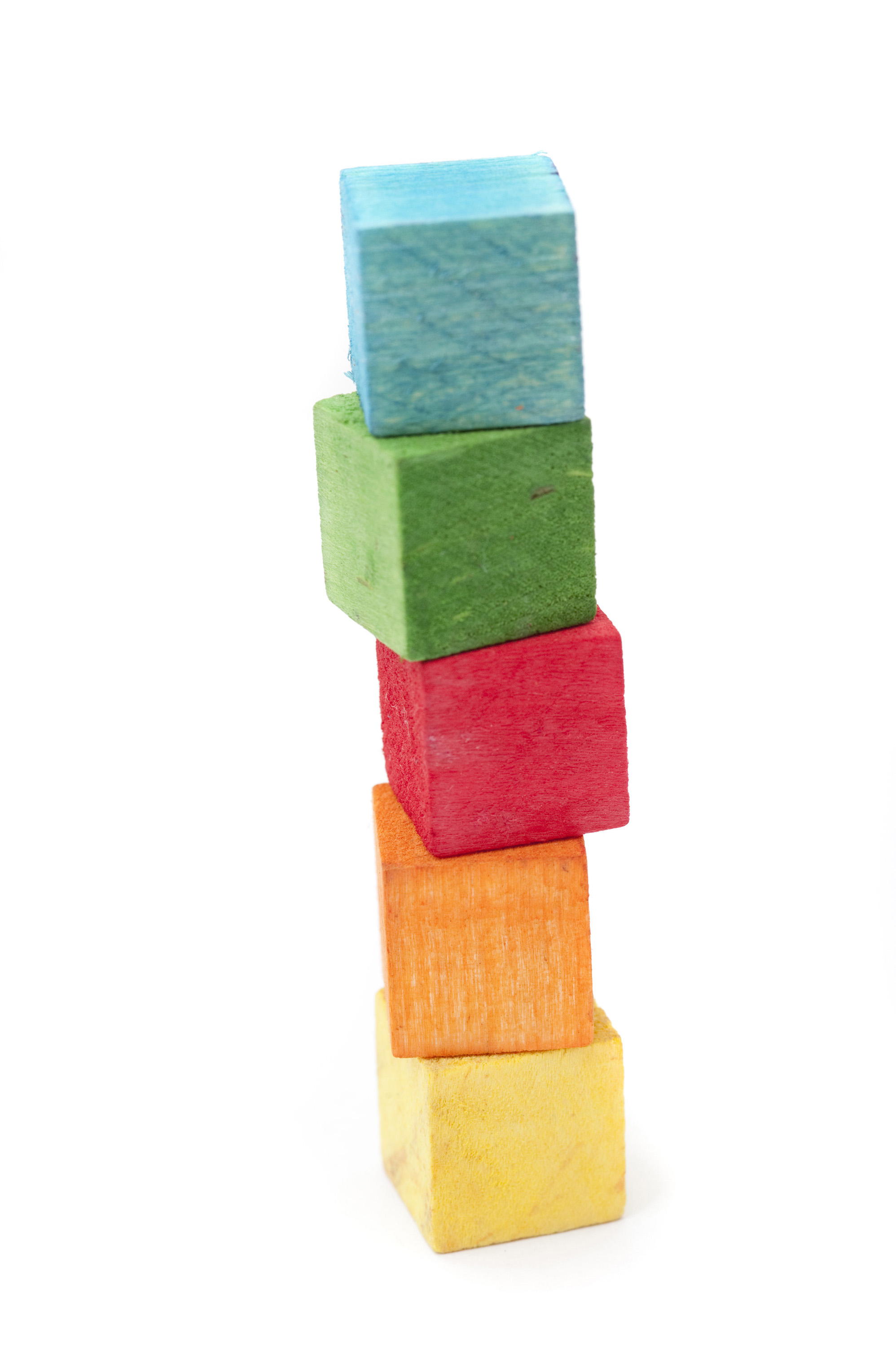 Free image of A tower of wooden building blocks.