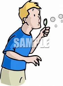Young Boy Blowing Bubbles.