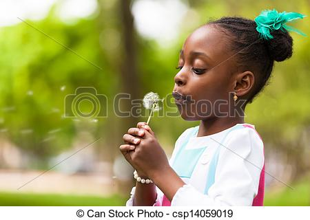 Stock Photography of Outdoor portrait of a cute young black girl.