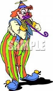 Clown Wearing a Beany and Blowing Up a Balloon.