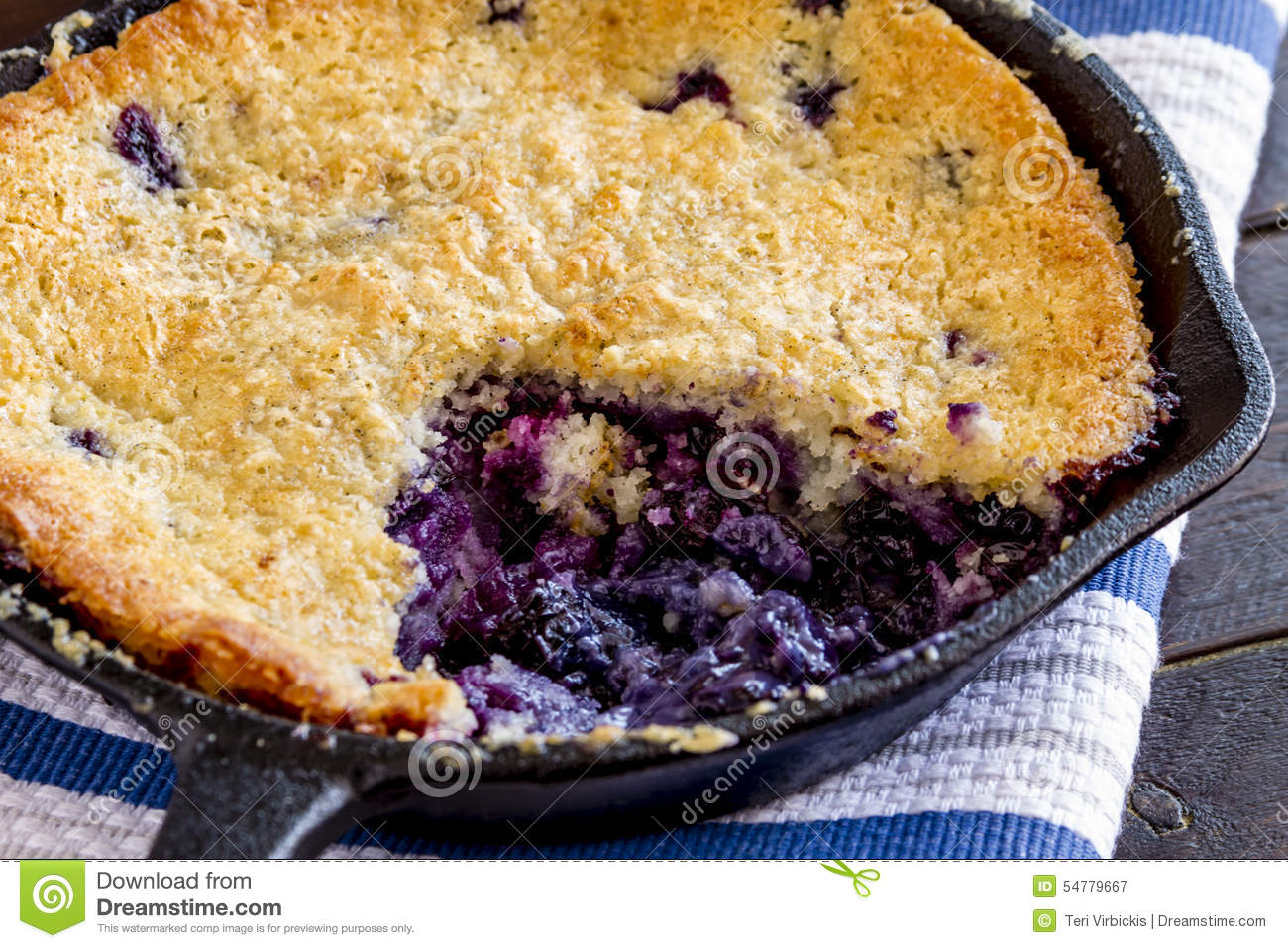 Blueberry Cobbler Baked In Cast Iron Skillet Stock Photo.