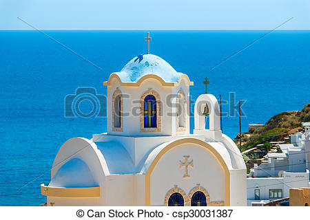 Pictures of Small Greek church with blue dome against the sea.