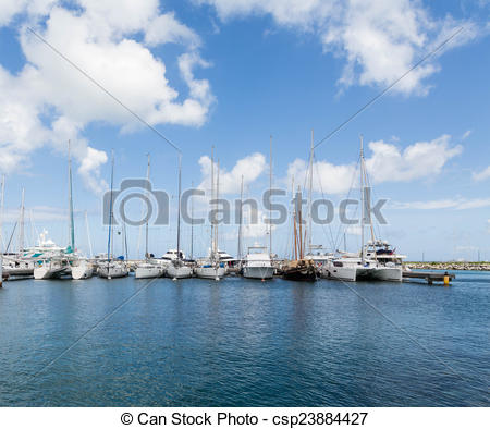 Clip Art of White Tall Masted Sailboats in Blue Harbor.
