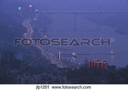Stock Photography of The blue haze of twilight encases the city of.