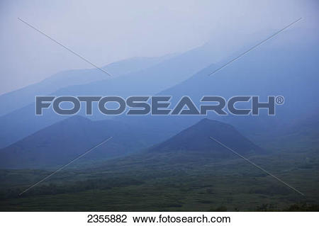 Stock Photo of Smoke From A Forest Fire Creates A Blue Haze That.