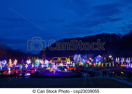 Stock Images of Village in Christmas lights blue hour view.