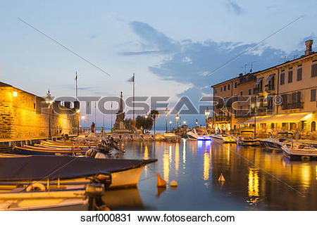 Stock Photography of Italy, Lake Garda, Lazise, harbor at blue.